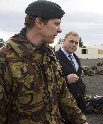 GRATEFUL: Major Craig Wilson is thankful for all the support he and his soldiers have received after being involved in a fatal battle in Afghanistan. He is pictured here in 2010 speaking with then Defence Minister Wayne Mapp.