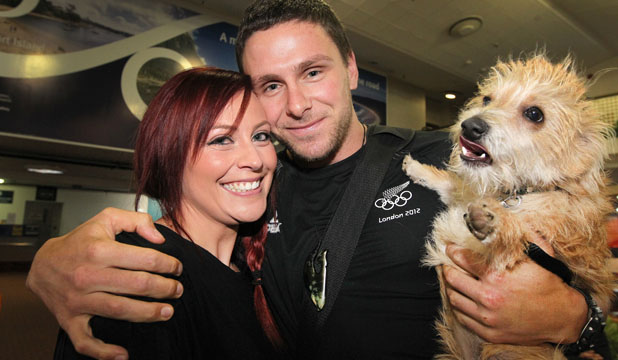 WELCOME HOME: Southland Olympian Eddie Dawkins is met by girlfriend O'Leah Black and puppy Winston at Invercargill Airport yesterday.