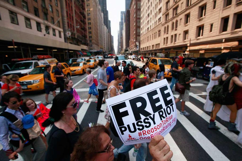 Protesters march through midtown Manhattan while demonstrating in solidarity with the Russian punk band Pussy Riot.