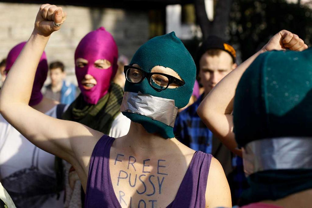 Activists wear masks and hold posters in support of members of the female punk band Pussy Riot during a protest rally in front of the Russian Embassy, in Warsaw.