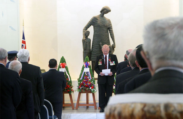 WE WILL NOT FORGET: Captain Lindsay Skinner reads the New Zealand Roll of Honour.