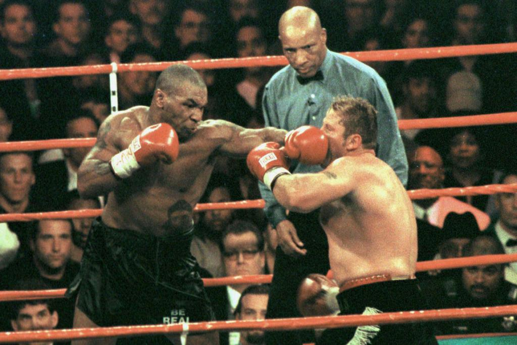 Mike Tyson gets the better of Botha.