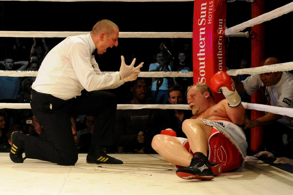 Botha is down for the count in the Heavyweight title fight last year against Michael Grant.