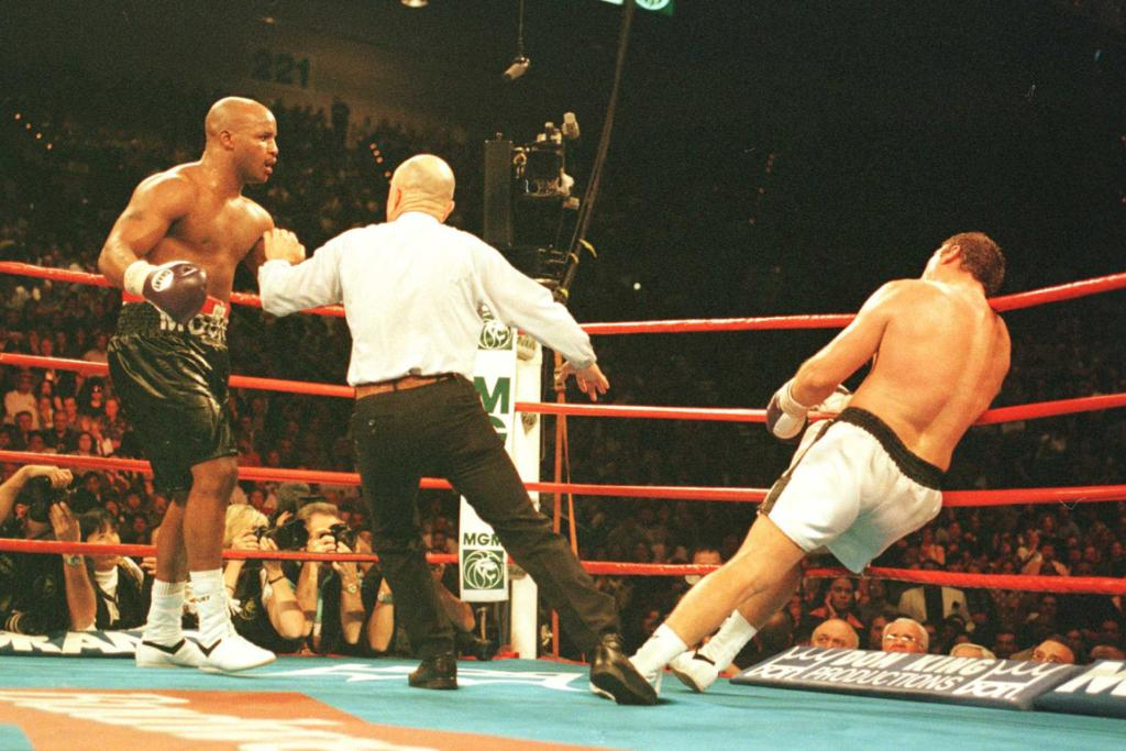 Michael Moorer (left) knocks out Francois Botha in the 11th round during their bout at the MGM Grand Garden in Las Vegas in 1996.