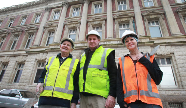 Five generations of Bob Ayers' family have worked on the Old Government Building in Worcester St. His grandfather laid the foundation stone in 1911. Ayers, left, has come out of retirement to work on the building with son Robin and granddaughter Suzane.