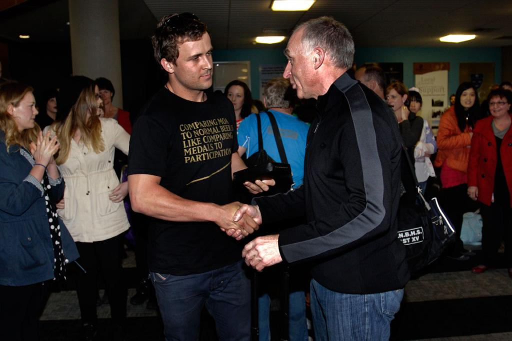 WARM WELCOME: Olympic cyclist and bronze medal winner Simon van Velthooven arrives at Palmerston North airport, where he was greeted by his coach Mike McRedmond.