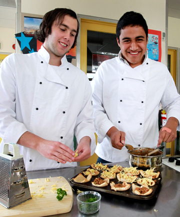 Spotswood College students Jordan Rust, 17, left, and Corey Bennett, 17, prepare Savory mince bread cases.