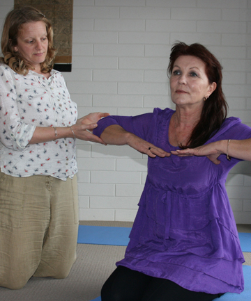 Feeling peace: Tessa Clarke corrects the position of Maggie MurrayÕs hands during a breathing exercise that encourages calmness.