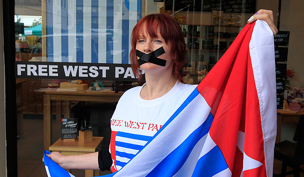 STAND AGAINST TYRANNY: Kirsty Keen, the Lush Cosmetics Nelson store manager, has her lips taped shut to signify the oppression of people  in West Papua who live under Indonesian rule.
