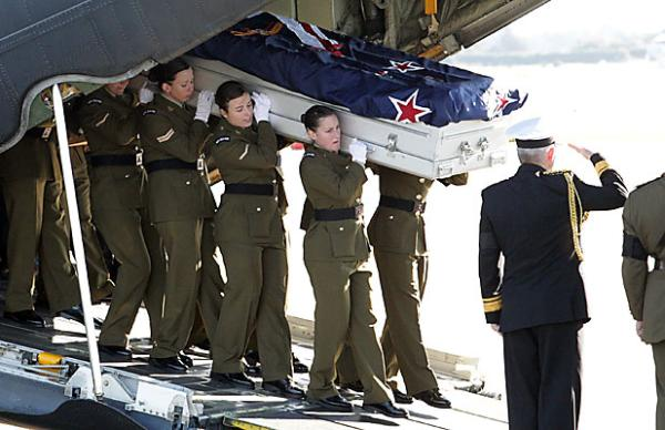 Jacinda Baker's coffin is carried out of the Hercules