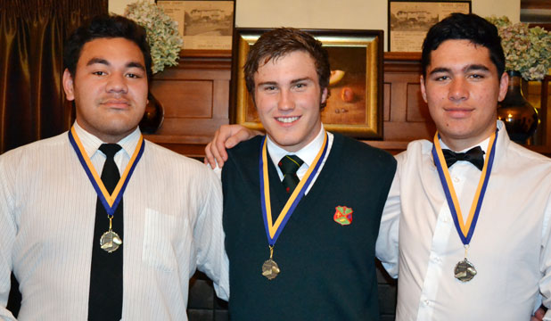 HALF-CENTURY: Roncalli's longstanding rugby trio of, from left, Carisbrook Toomalatai, Daniel Dorgan and Robert Mulvena have been honoured by their school.