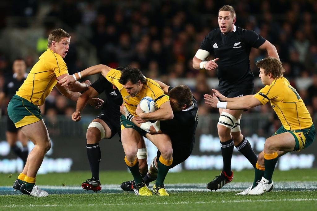 Adam Ashley-Cooper is hauled down in the tackle by Richie McCaw.