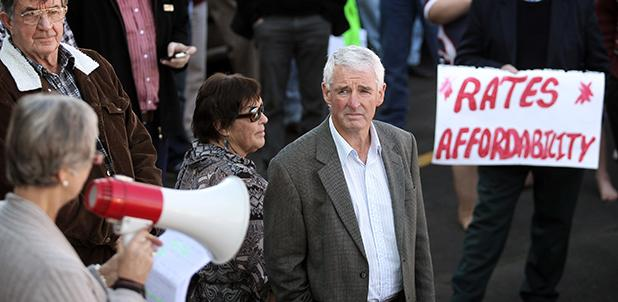 """LOTS OF ISSUES"": Waipa Mayor Alan Livingston listens to march organiser Robin Duncan."