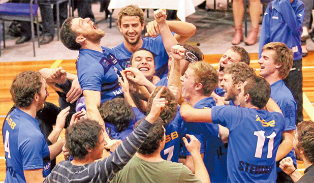 JUBILANT: Nelson Pines men, with captain Pat Shone, being lifted by his team-mates, celebrate after winning the national club volleyball championships on Saturday.