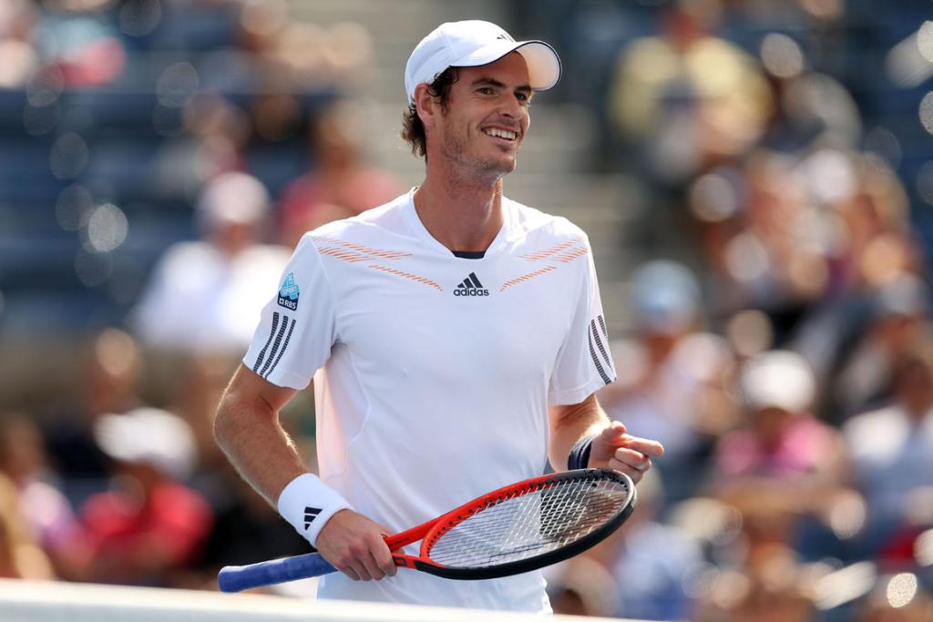 Andy Murray is all smiles during his first round match against Alex Bogomolov Jr of Russia.