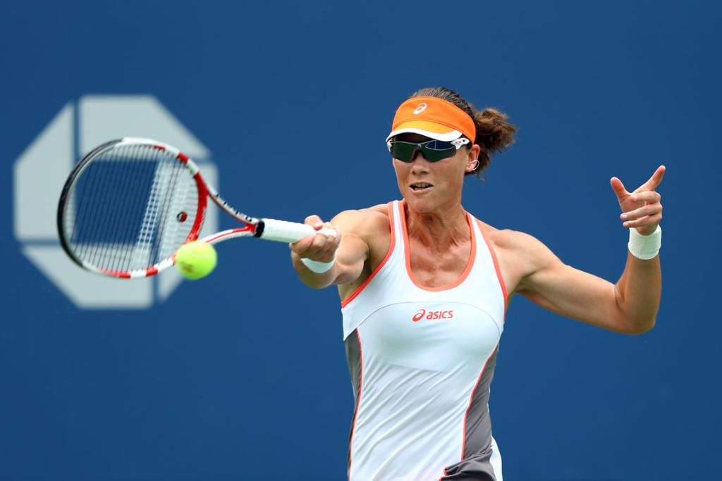 Sam Stosur returns a ball during her first round win over Petra Martic.