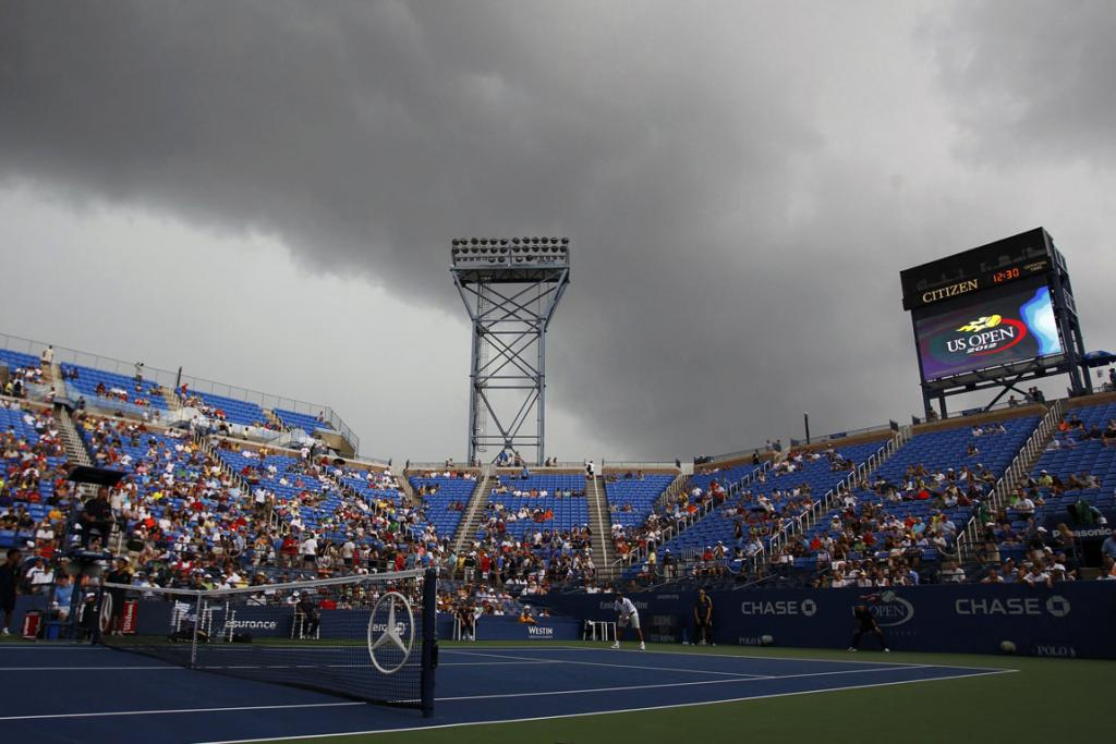 Dark clouds loom over Flushing Meadows on day one of the US Open.