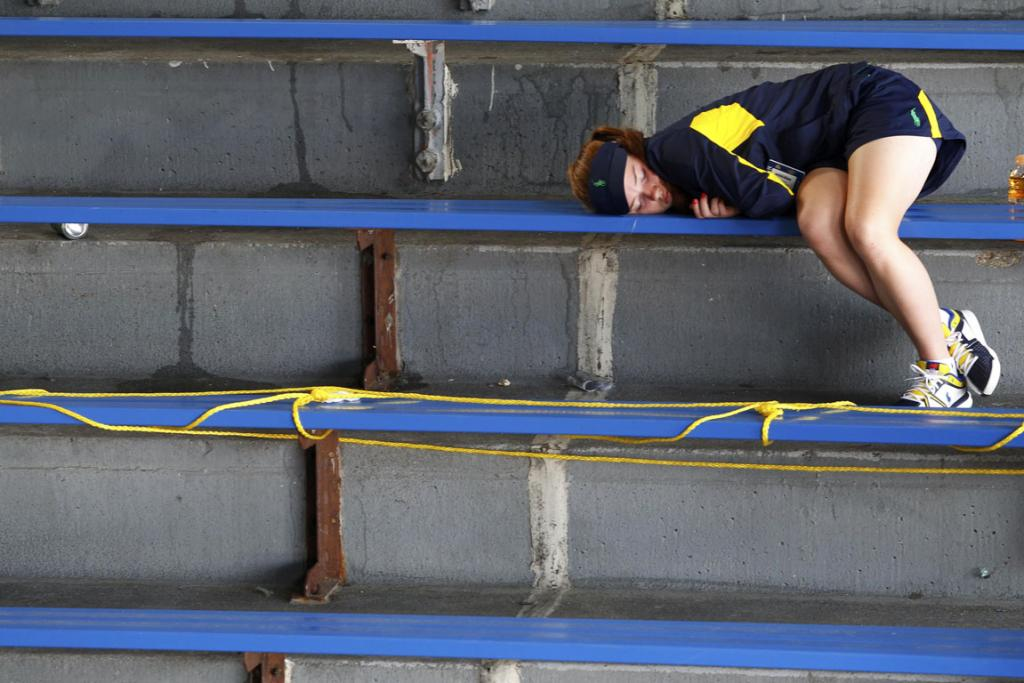 It's all too much for some as a ball girl takes a nap in the stands.