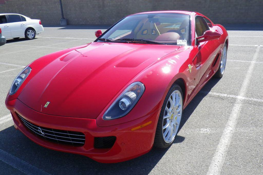 If Ronald McDonald had a Ferrari it seems likely the inside colour scheme of this Ferrari 599 is just for him.