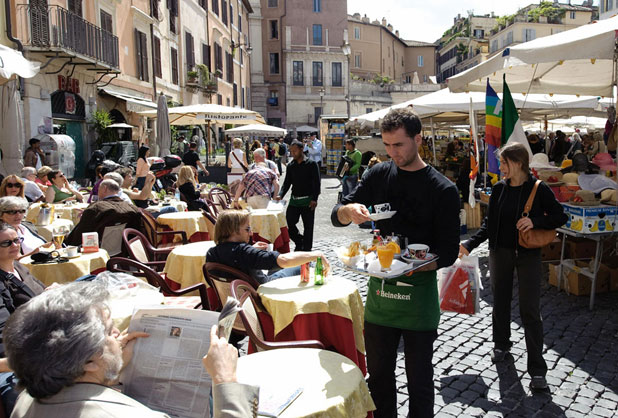 SPOILED FOR CHOICE: In a city where your trousers get tighter simply by being there, the only problem is choosing where to eat. Here, travellers enjoy sunshine and great service in Campo dei Fiori.