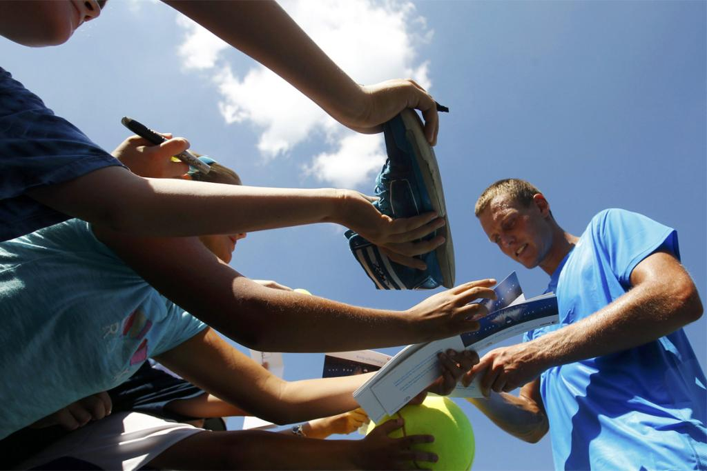 Thomas Berdych signs autographs for fans.