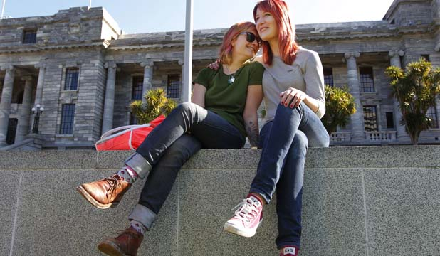 WHY CAN'T WE MARRY? Kyasha Robinson, 20, left, and Belle Mayston, 21, say civil union ''sounds  cold, like a business partnership''. Marriage is more appealing to the couple – ''we'd be able to flaunt it''.