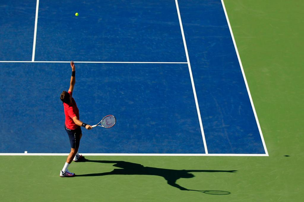 Juan Martin Del Potro in mid serve during his first round match.