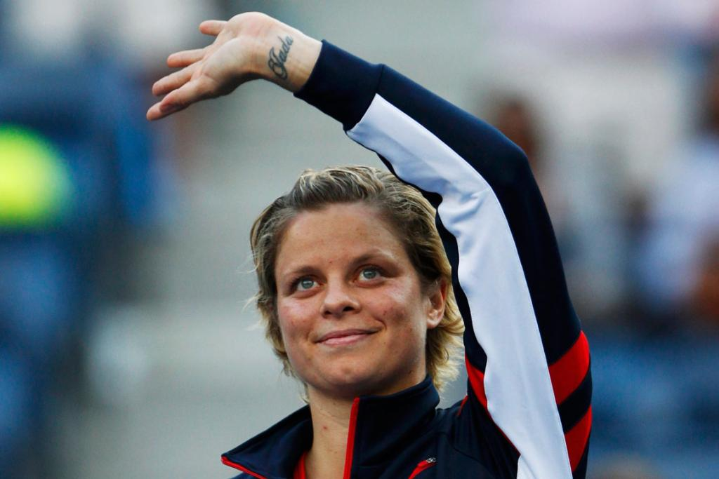 Reitring Kim Clijsters waves goodbye for the last time to the Flushing Meadows crowd after her defeat to British teen Laura Robson.
