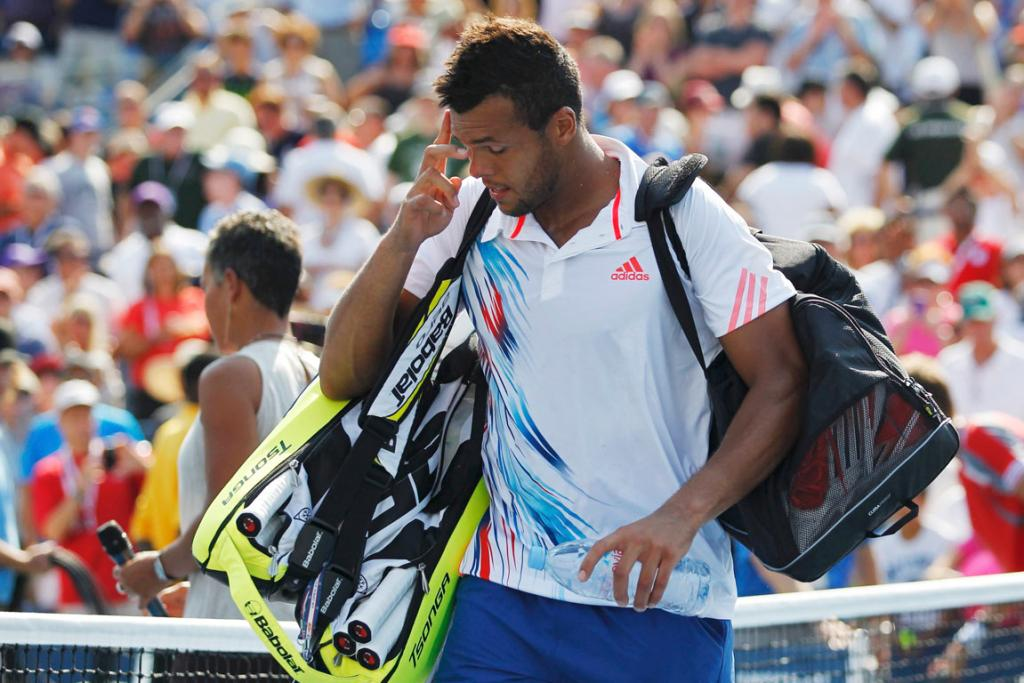 Jo-Wilfried Tsonga packs his bags and exits the US Open after his four-set loss to Slovakian Martin Klizan in the second round.