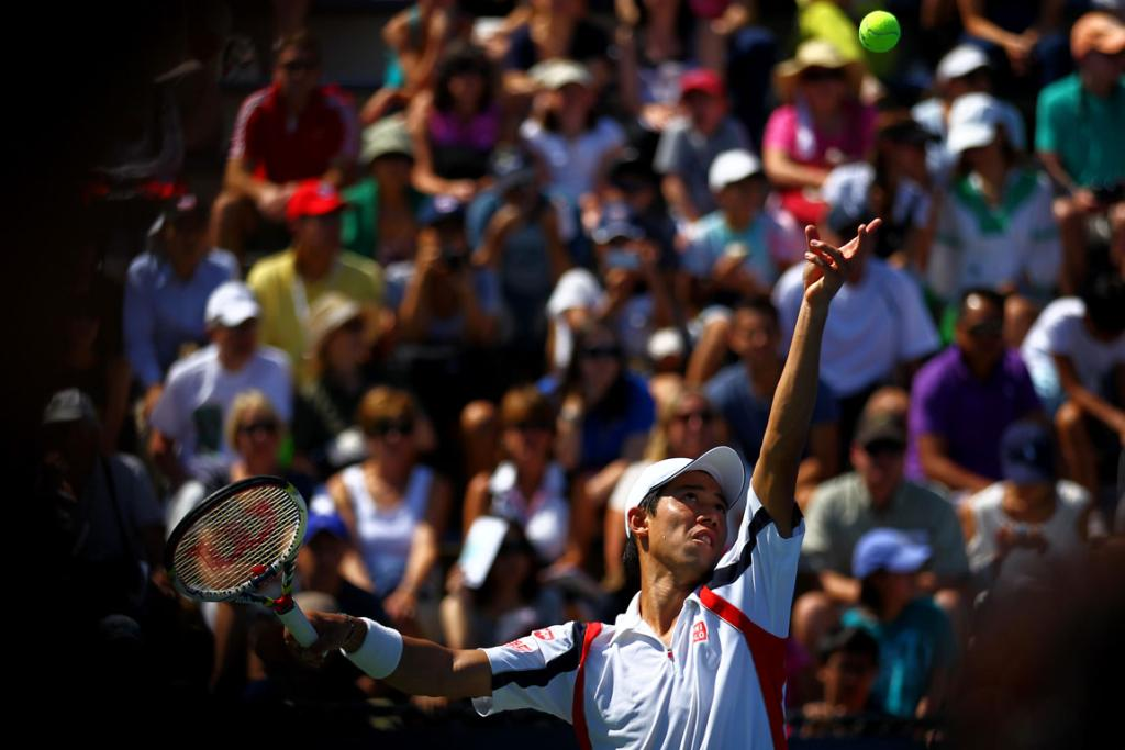 Kei Nishikori of Japan serves against Tim Smyczek in the second round.