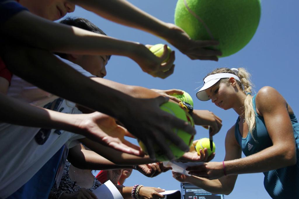 Maria Kirilenko signs autographs for fans after her second round win.