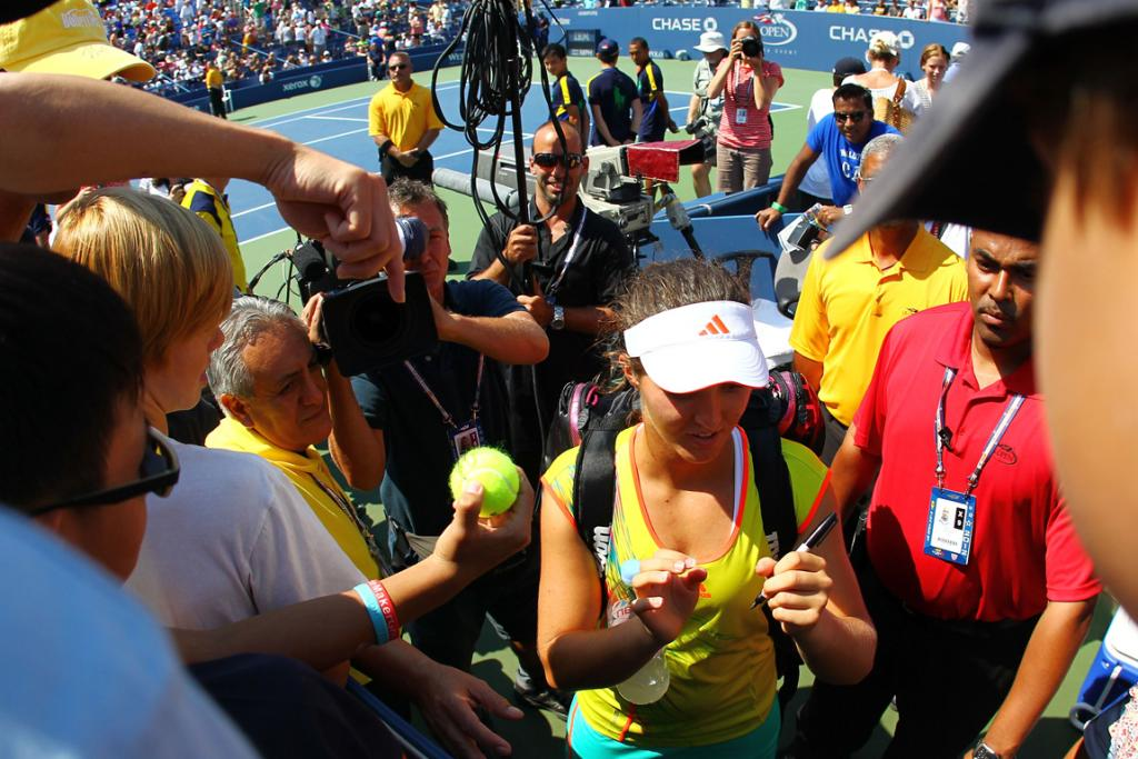 Teenager Laura Robson is swamped by fans and media after beating Li Na.