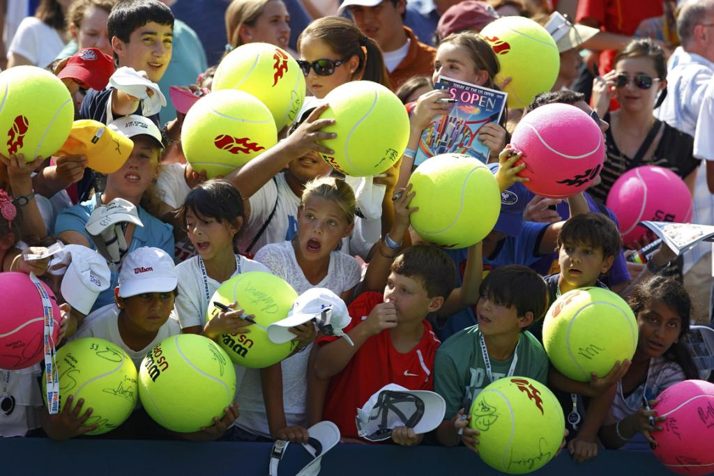 Kids clamber for autographs at the US Open.
