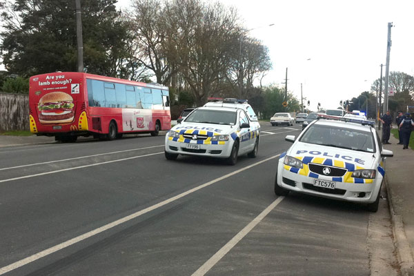 Police attend to a callout after an incident on a Red Bus today.