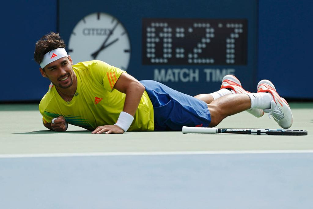 Fabio Fognini hits the court after being beaten by a shot from American Andy Roddick.