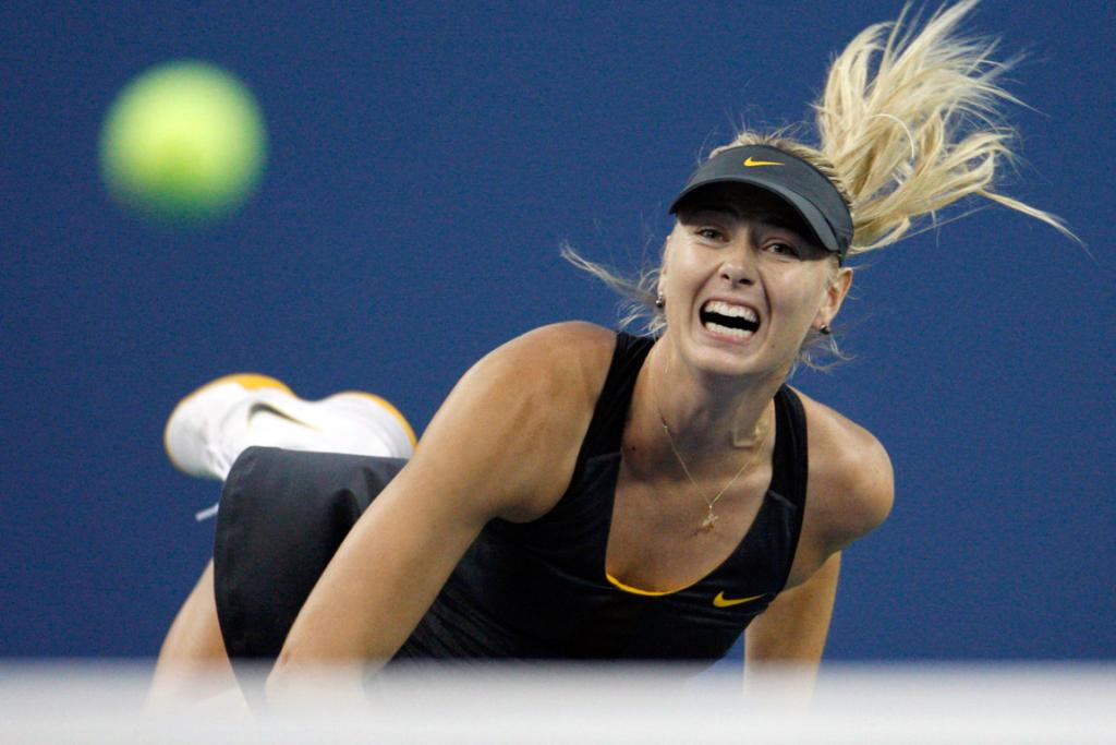 Maria Sharapova serves against Nadia Petrova during their round of 16 match.