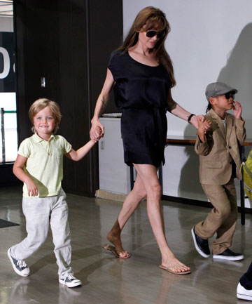 Shiloh Jolie Pitt, pictured here in 2010 with her mum and big brothers