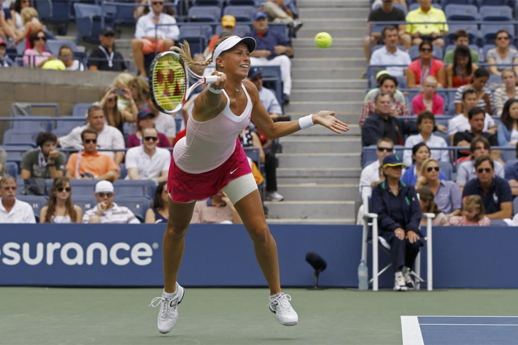 Andrea Hlavackova of the Czech Republic lunges for a return against Serena Williams.