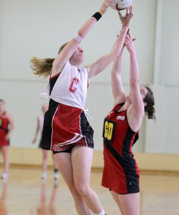 ELEVATION: Counties Manukau centre Kirsten Hurley goes high to beat an Eastern player to the ball during their national netball championship match at Strathallan College in Karaka last Sunday.