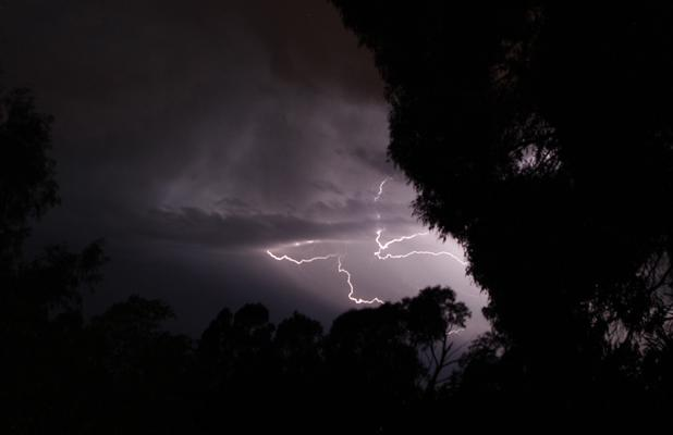 DARK NIGHT: Lightning across the sky tonight.