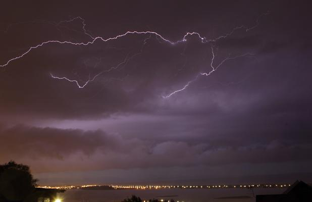 PURPLE SKY: The electrical storm as seen from Redcliffs.