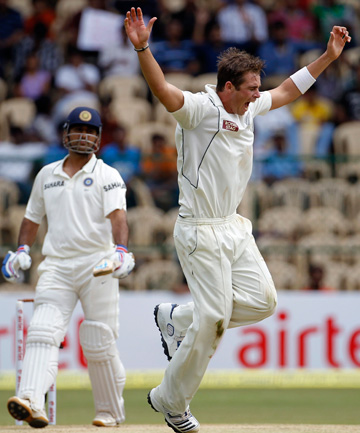 SHINING LIGHT: New Zealand's Tim Southee celebrates taking the wicket of India's captain Mahendra Singh Dhoni.