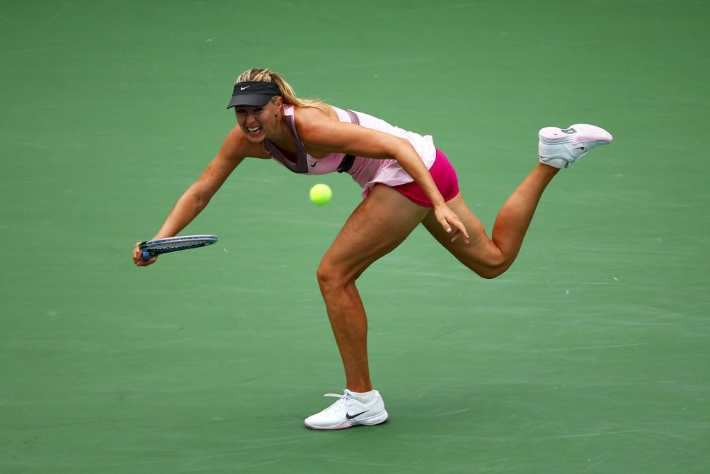 Maria Sharapova stretches for the ball during her quarter-final win over Marion Bartoli.