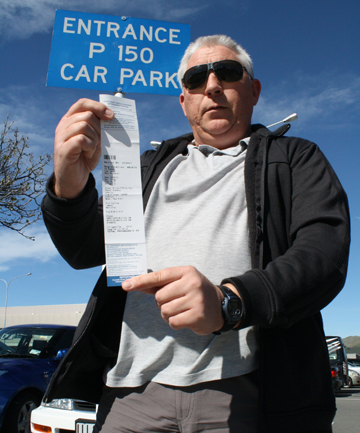 Ticketed off: Witherlea resident John Jackson with the $12 fine he got for overstaying his parking limit while watching a long film at the Top Town Cinema in Blenheim.