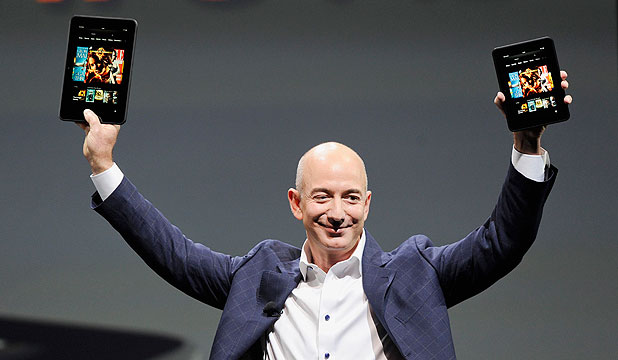 "LAUNCH: Amazon CEO Jeff Bezos holds up the new Kindle Fire HD 7"" and Kindle Fire HD 8.9""."