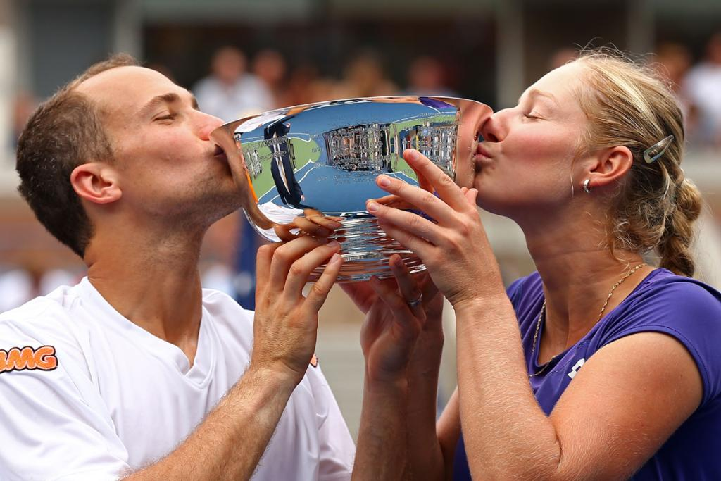 Ekaterina Makarova and Bruno Soares celebrate their win in the mixed doubles.