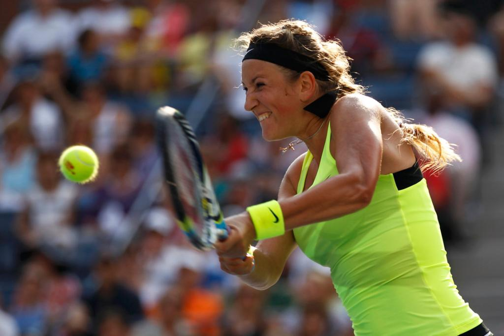 Victoria Azarenka plays a backhand shot as she outlasted Maria Sharapova to reach the women's singles final at the US Open.