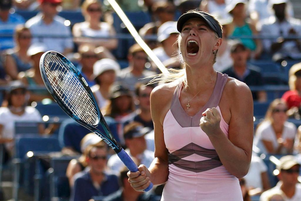 Maria Sharapova screams after winning a vital point against Victoria Azarenka in the US Open women's semifinals.