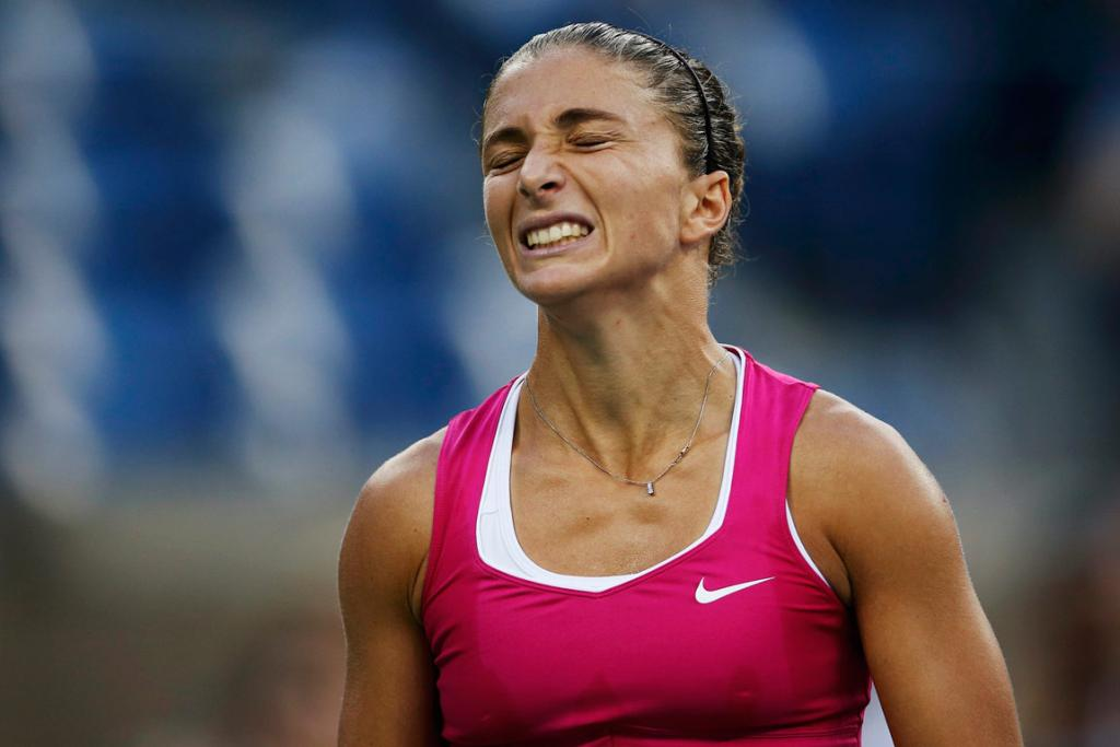 Italy's Sara Errani feels the pain of a crushing semifinal defeat at the hands of Serena Williams.