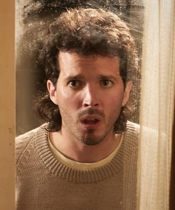 "SERIOUSLY, FOLKS: Bret McKenzie as bank teller Nige in Two Little Boys. Wait until you see his mullet - ""just a slight trim on the sides"", he says."